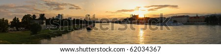 Danube River and sunset over Bratislava Castle - stock photo