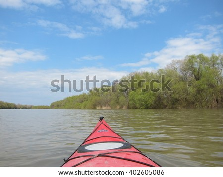 DANUBE RIVER, UKRAINE - MARCH 27, 2016: View from the red kayak on spring Danube river.