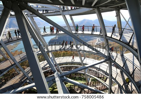 DANYANG, SOUTH KOREA : OCTOBER 31, 2017 - Tourists walking up the Mancheonha Skywalk tower in Danyang. The tower is one of the popular tourist stops in Danyang County in South Korea.
