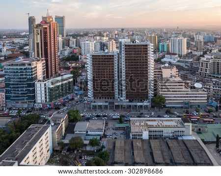 DAR ES SALAAM, TANZANIA - JUNE 08, 2015: Modern skyscrappers in downtown of Dar es Salaam in Tanzania, East Africa, in the evening, at sunset. Horizontal orientation. - stock photo