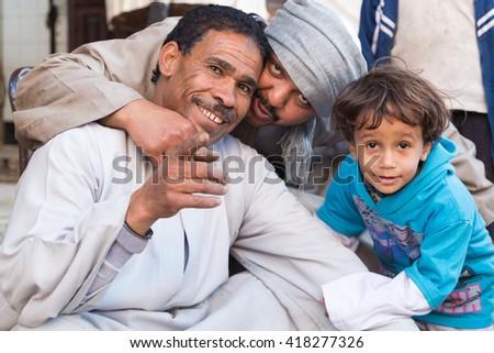 DARAW, EGYPT - FEBRUARY 6, 2016: Local family posing for camera at Daraw market. - stock photo