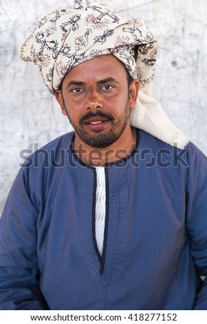 DARAW, EGYPT - FEBRUARY 6, 2016: Portrait of local camel salesman with turban. - stock photo
