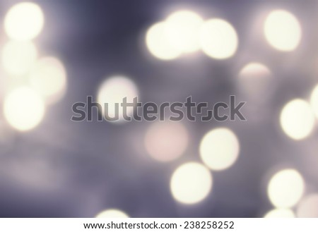 Dark Abstract Lights Festive  Sparkling  background with defocused  texture. Abstract night  twinkled bright background with bokeh lights - stock photo