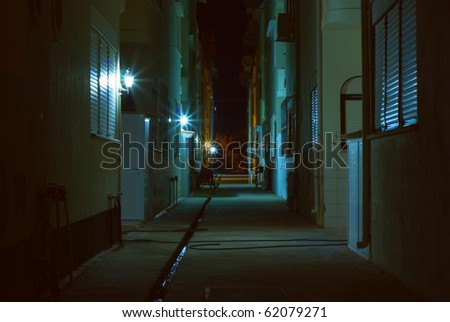Dark alley at night - stock photo