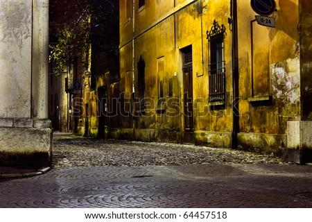 dark alley at night, narrow dirty corner, street  in the old town - stock photo