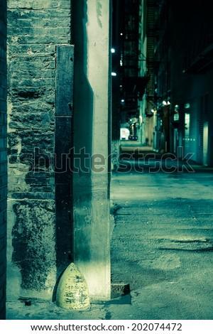 Dark Alley Corner. Chicago Alley at Night. Vertical Photo. - stock photo