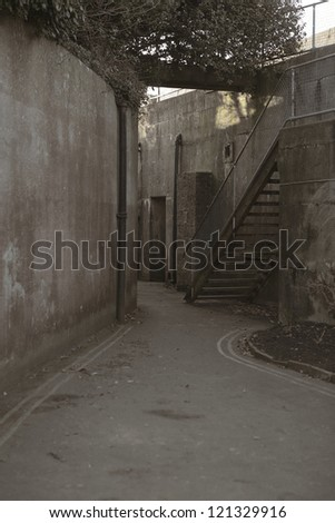 Dark alley down a side street on the island of isle of white - stock photo