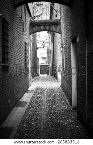 Dark Alley in Black and White in Italy - stock photo