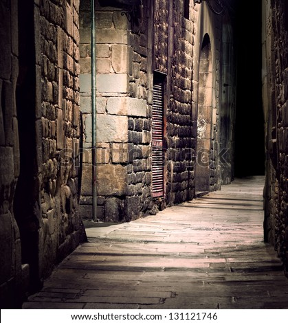 Dark alley in old part of town - stock photo