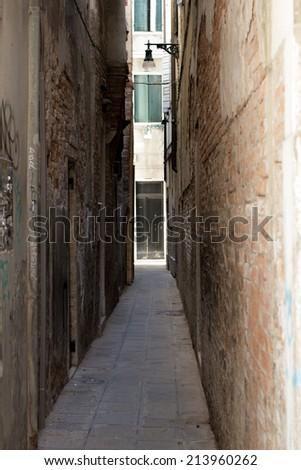Dark alley in Venice - stock photo