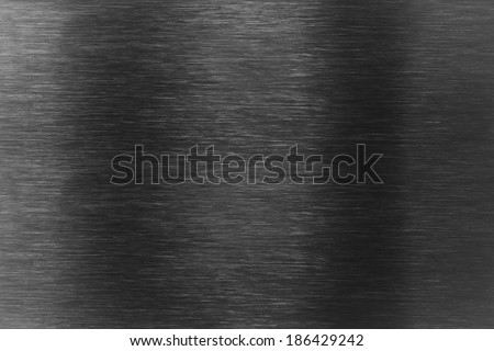 Dark aluminum metal surface as background - stock photo