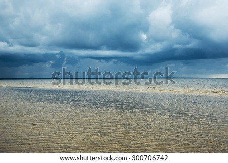 Dark and dramatic clouds above gulf of Riga, Baltic sea.