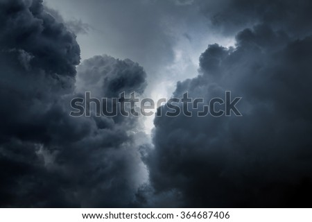 Dark and Dramatic Storm Clouds Area Background - stock photo