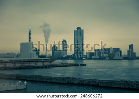 Dark and gloomy industrial scene along the ports of Osaka, Japan.