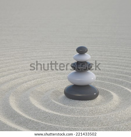Dark and white zen stones stacked on a wide sands symbol for calmness and relaxation - stock photo