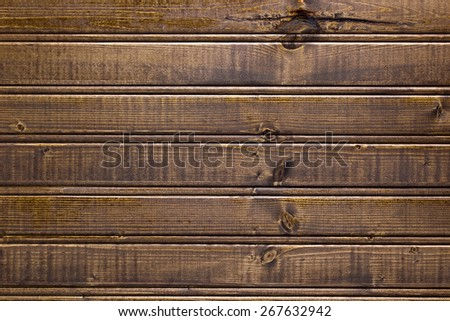 Dark background of painted wood for industrial purposes.