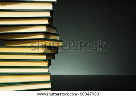 Dark background with books in the form of DNA chain for any design project - stock photo