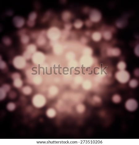 Dark Beautiful Festive Abstract Christmas twinkled background with bokeh defocused golden lights. Holiday party background with blurry boke special magic effect. - stock photo