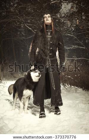 Dark beauty and dog male - stock photo