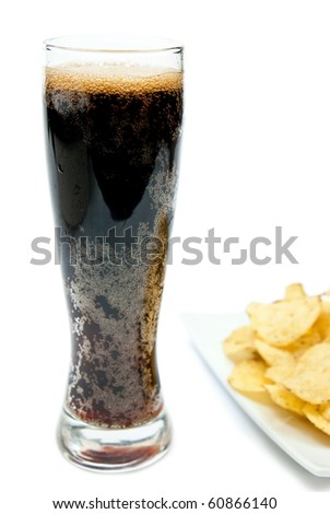 Dark beer and chips isolated on white