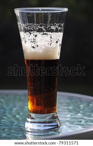 Dark beer in glass - stock photo