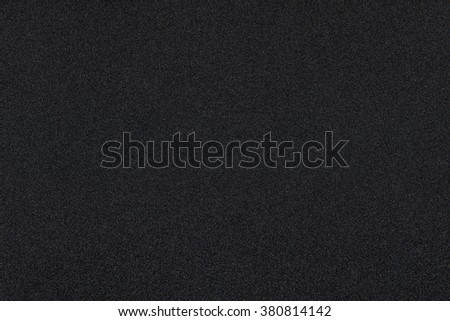 Dark black background texture with shiny speckles of random colour noise - stock photo