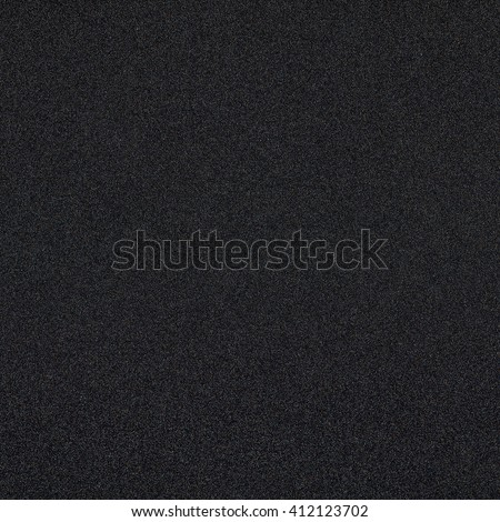 Dark black background texture with shiny speckles of random colour noise texture - stock photo