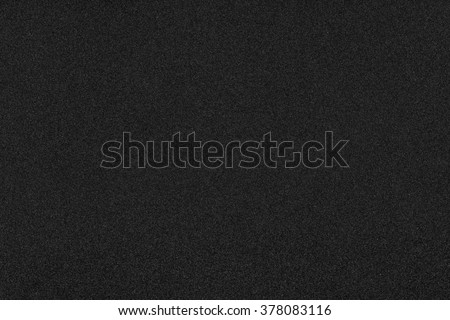 Dark black background texture with shiny speckles of random noise - stock photo
