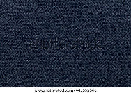 Dark blue background from a textile material. Fabric with natural texture. Cloth backdrop. - stock photo