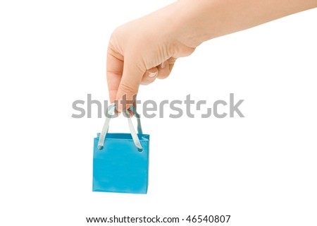 Dark blue bag in a female hand - stock photo