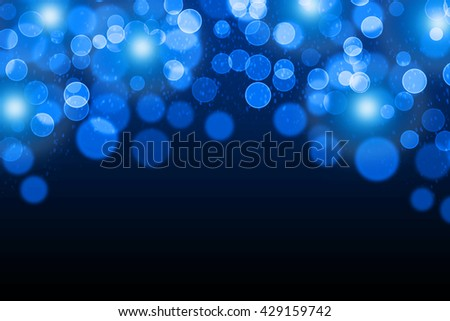 Dark-blue bokeh background with lights and place for text