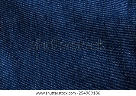 Dark Blue Denim Jean Fabric / Concept and Idea of Denim Industry, Sewing and Fashion, Vintage Rustic Style. For Pattern, Background, Wallpaper and Textured. - stock photo
