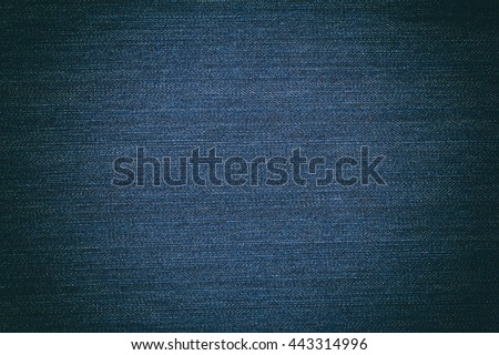 Dark blue, denim texture. Fabric texture of the jeans. Closeup