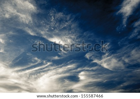 dark blue evening sky with clouds - stock photo