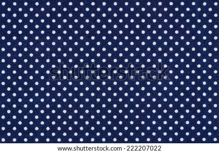 Dark blue fabric with white polka dots - stock photo
