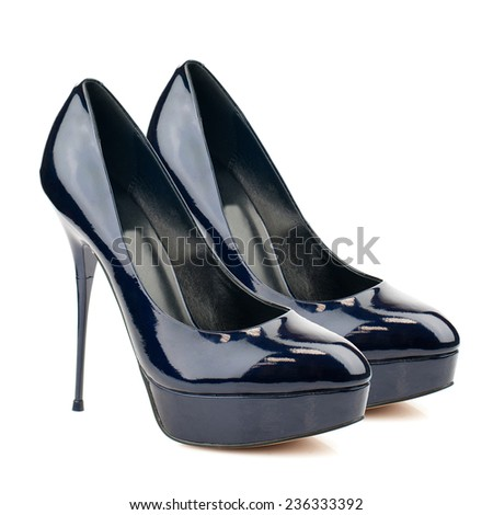 Dark blue glossy stilettos isolated on white background.