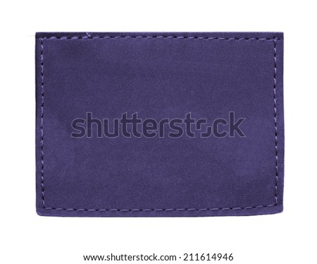dark blue jeans leather label  isolated on  white  - stock photo