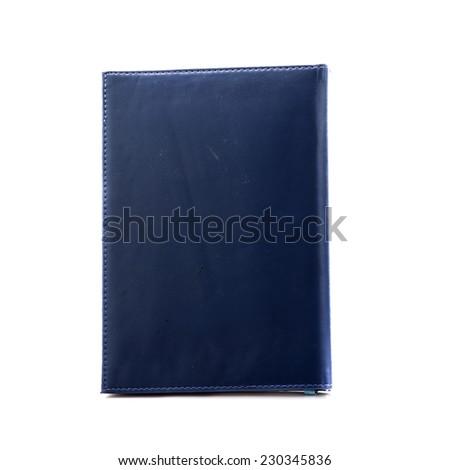 Dark blue notebook isolated on white. - stock photo