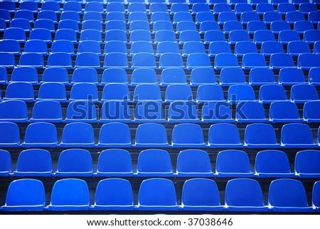 Dark blue rows of seats on the stadium - stock photo