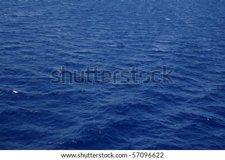 Dark blue sea water surface with ripple can use as background - stock photo