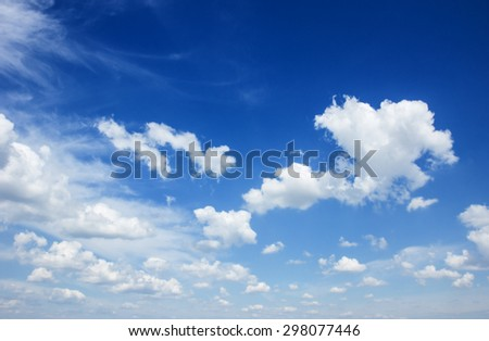 Dark Blue  sky background with puffy  white clouds  - stock photo