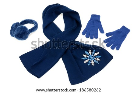 Dark blue winter accessories isolated. Wool scarf, a pair of gloves and earmuffs nicely arranged on white background. - stock photo