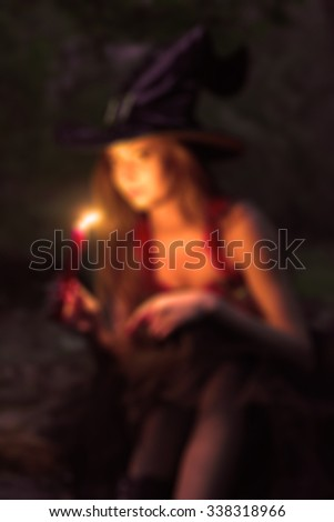 Dark blurred background girl with candle