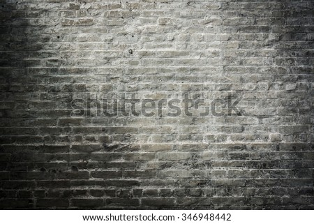dark brick wall, black and gray brick weathered texture background - stock photo