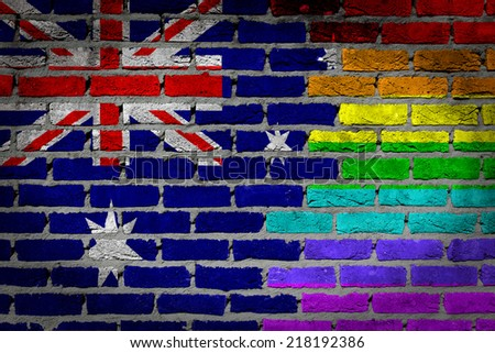 Dark brick wall texture - country flag and rainbow flag painted on wall - Australia - stock photo