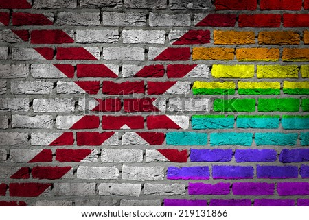 Dark brick wall texture - coutry flag and rainbow flag painted on wall - Alabama - stock photo