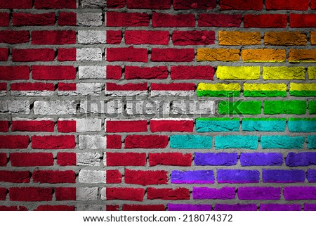 Dark brick wall texture - coutry flag and rainbow flag painted on wall - Denmark - stock photo