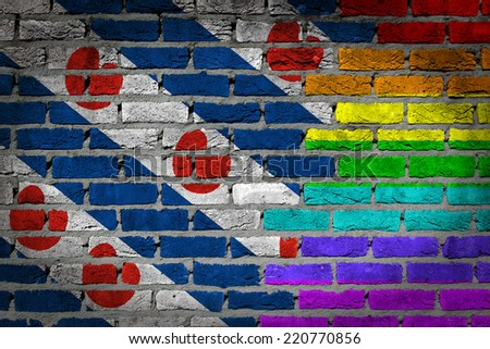 Dark brick wall texture - coutry flag and rainbow flag painted on wall - Friesland - stock photo