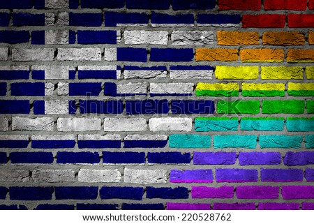 Dark brick wall texture - coutry flag and rainbow flag painted on wall - Greece - stock photo