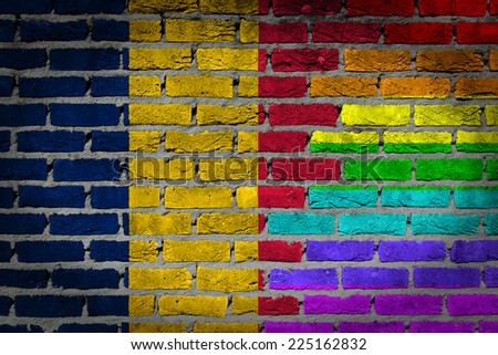 Dark brick wall texture - coutry flag and rainbow flag painted on wall - Romania
